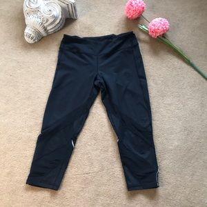 Black workout capri pants with mesh panels